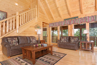 Livingroom Area that has a wooded view and comforable furniture
