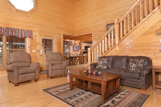Pigeon Forge Four Bedroom Cabin Rental that features a surround sound theater system and flat screen televelsion