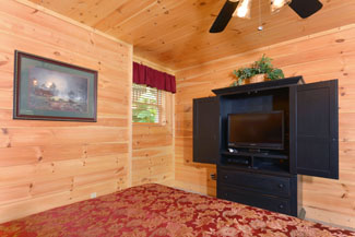 Pigeon Forge Four Bedroom Cabin Rentals with a flat screen television