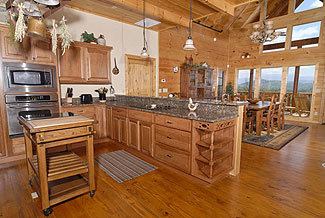 Deluxe cabin kitchen great for thanksgiving, holidays, or a night in at the cabin.Enjoy the view from the mountain view from the kitchen.