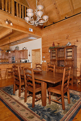 Deluxe Cabin dinning room area with plenty of seating overlooking a Smoky Mountain View