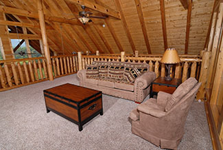 Lofted area seating room with amountain view
