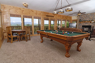 Lower Level area in the cabin that features a livingroom,game room, and a bar