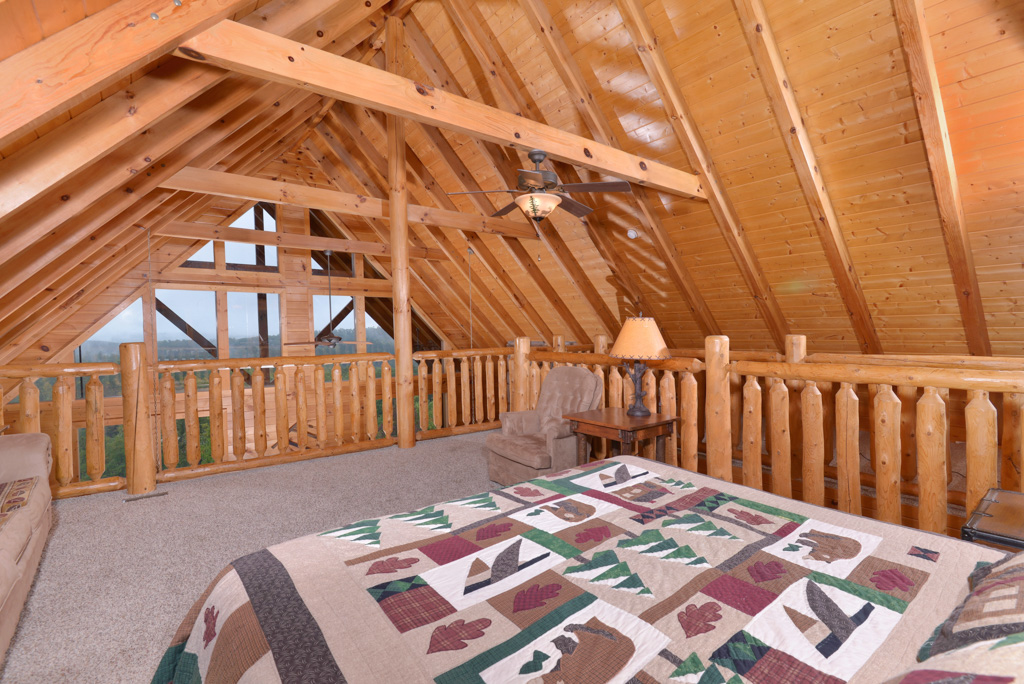 Pigeon Forge Luxury Cabin large loft area with a panoramic mountain view