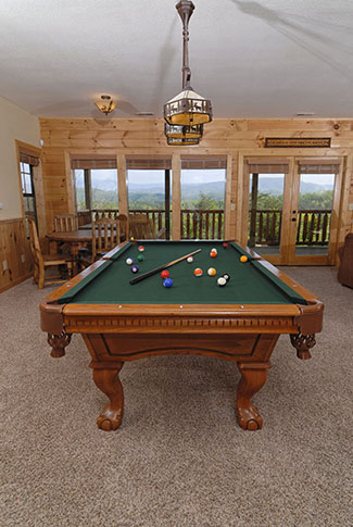 Four Bedroom Cabin with a lower level gameroom and bar area that has a pool table overlooking a mountain view
