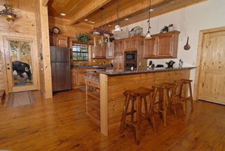 Deluxe kitchen that features a microwave,coffee maker, and a dishwasher with all wood interior