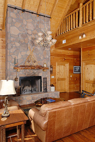 Livingroom fireplace with the vaulted wood ceilings
