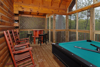 Pigeon Forge Cabin that has a pool table and a sitting area