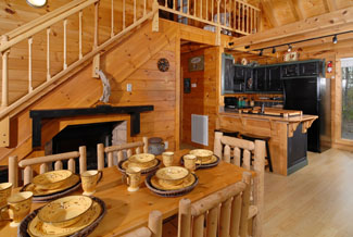 Two bedroom Cabin in the woods with a great dinning and kitchen area overlooking a wooded scenery