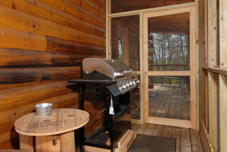 Pigeon Forge Two Bedroom Cabin with a gas grill for some cooking the cabin