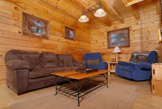 Pigeon Forge two bedroom cabin living area that has 2 recliners and a pull out sofa sleeper