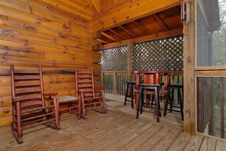 Two Bedroom Cabin with an outdoor seating area for grilling out or for a place to rest while shooting some pool.