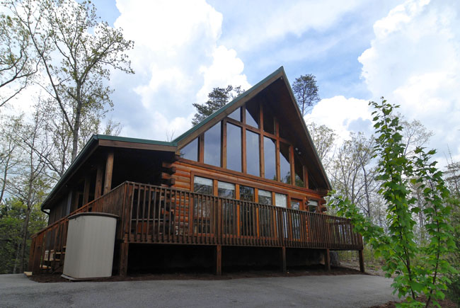 Pigeon Forge Two Bedroom Cabin that has an outdoor pool table and a  hot tub