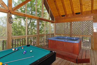 Pigeon Forge Two bedroom Cabin with an outdoor pool table wooded view and an outdoor hot tub