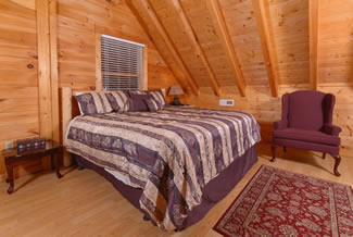 Pigeon Forge Two Bedroom Cabin Rental that has an upstairs Bedroom