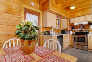 Smoky Mountain Cabin Rental Fully Equipped Kitchen with a Dinning Area that seats four
