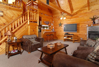 Pigeon Forge Living Room Area that features all wood interior-flat screen television-gas fireplace