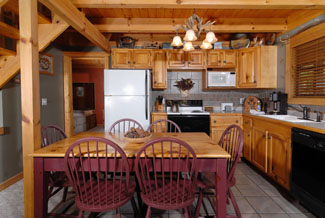 Pigeon Forge Cabin that features a kitchen area that has a dinning room table