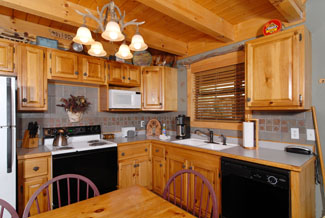 Pigeon Forge Cabin that has a fully equipped kitchen