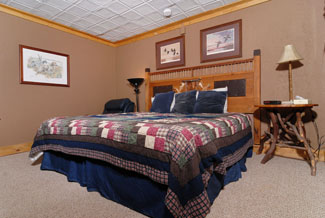 Pigeon Forge Three Bedroom Cabin that features two suite master bedroom