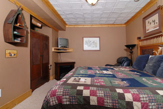 Pigeon Forge Three Bedroom Cabin Rental that has an in suite master bedroom