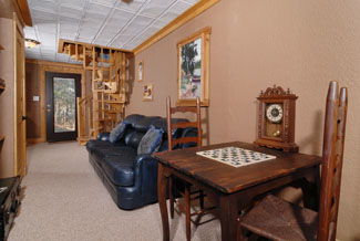 Pigeon Forge Cabin that features a lower level seating area for the game room