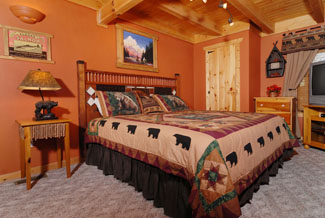 Pigeon Forge Cabin Master Bedroom that features an in suite whirl pool and television