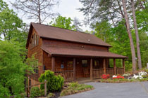 Pigeon Forge Private Three Bedroom Cabin with a Gameroom,whirl pools, hot tubs, pool table,dart board, and an outdoor playground area