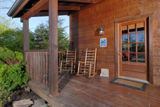 Pigeon Forge Vacation Cabin Rental with a Front Porch area with Rocking Chairs