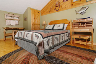 Pigeon Forge Three Bedroom Cabin that features two queen sized beds in the upper level bedroom