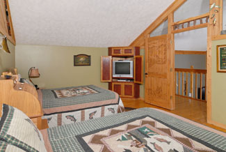 Pigeon Forge Uppter Level Bedroom features a television