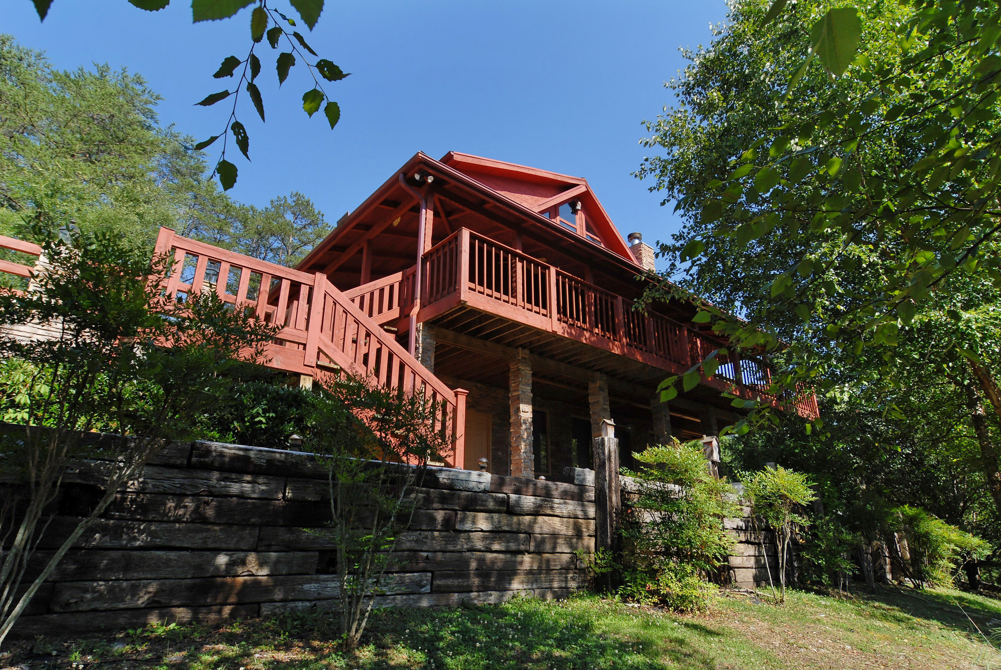 Pigeon Forge Two Bedroom Cabin plus a bonus room with a pool table, hot tub, and a nice yard close to dowtown Pigeon Forge.