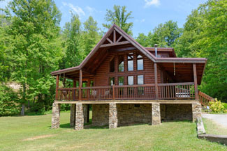 Pigeon Forge Two Bedroom Cabin Featuring Semi Seclusion-Stocked Fishing Pond- Two Bedrooms with Two Queen Beds and a Hot Tub