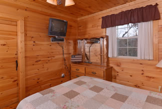Pigeon Forge Cabin Rental Main Level Bedroom TV