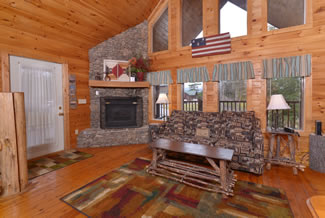 Pigeon Forge Cabin Rental Livingroom Area with a Gas Fireplace