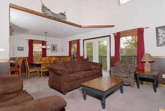 Pigeon Forge Chalet with Comfortable Microfiber Livingroom area with a Flat Screen TV and a Gas Fireplace for great Vacation Entertainment