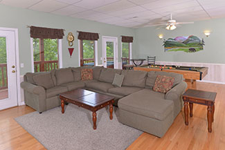 Three Bedroom Covenient Chalet Rental Lower Level Gameroom Seating Area