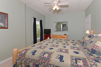 Pigeon Forge Cabin Rental Lower Level Bedroom Area