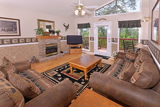 Pigeon Forge Cabin Rental Main Level Living Area with Flat Screen Television and Fireplace