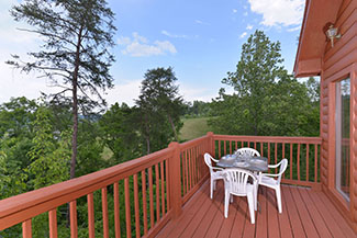 Convenient Pigeon Forge Three Bedroom Chalet Rental Outdoor seating Area great for your Morning Coffee