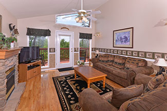 Pigeon Forge Three Bedroom Chalet Rental Main Level Livingroom with Fireplace