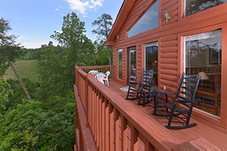 Upper Level Cozy Outdoor Seating Area on this Three Bedroom Chalet