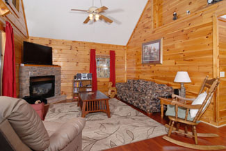 Pigeon Forge Cabin Seating area overlooking a mountain-town view