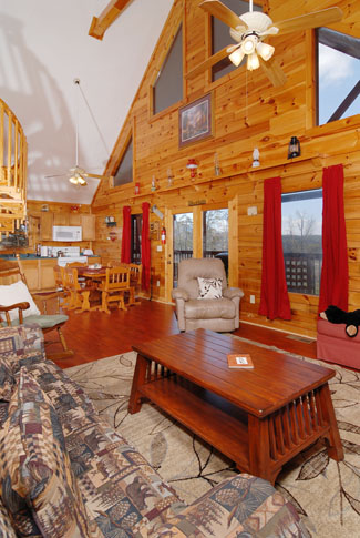 Pigeon Forge Cabin with a vaulted ceiling livingroom area and hardwood floors