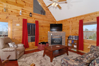 Pigeon Forge Cabin Living Room with a gas fireplace and a flat screen tv for enjoyment