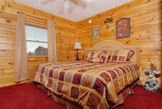 Pigeon Forge Three Bedroom Cabin Rental that features a Flat Screen TV in the Bedroom