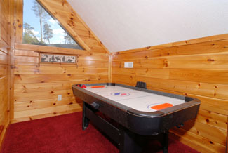 Pigeon Forge Cabin that features an airhockey table in the upper level loft