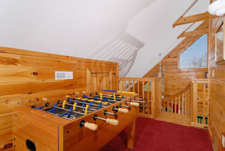 Pigeon Forge Cabin that has a Foosball Table in the Upper Loft Area