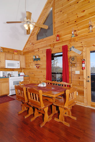 Pigeon Forge Cabin that features vaulted ceilings in the dinning room area that seats six guests