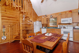 Pigeon Forge Cabin that features a Spiral Staircase to the second level gameroom area